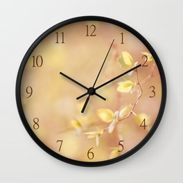 Many young spring leaves on blurred background Wall Clock