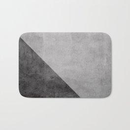 Concrete with black triangle Bath Mat