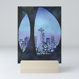 Watercolor painting of downtown Seattle, WA skyline with Space Needle as viewed through sculpture on Mini Art Print