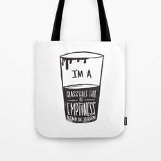 glass half full of emptiness Tote Bag