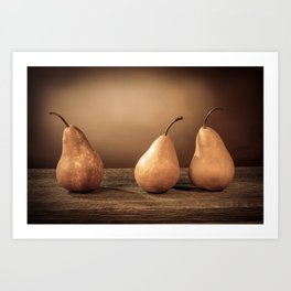 Three large yellow bosc pears on a barn wood table yellow effect filter Art Print