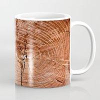 tree rings Mugs featuring Tree Rings by rebecca haegele