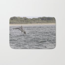 Playful young dolphin Bath Mat
