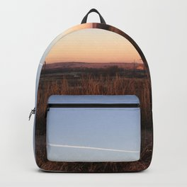 Sunset at small town Backpack