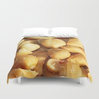 peanuts Duvet Covers featuring food, many small salted peanuts by Marina Kuchenbecker