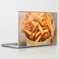 french fries Laptop & iPad Skins featuring Fries in French Quarter, New Orleans by va103