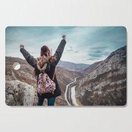 Tourist on the peak of high rocks. Big canyon on Balkan peninsula Cutting Board