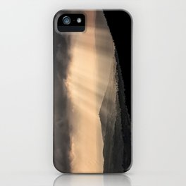 Sunbeams illuminate the hills below iPhone Case