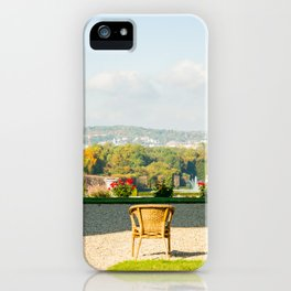 A couple of chairs on the top of a lookout watching the landscape I iPhone Case