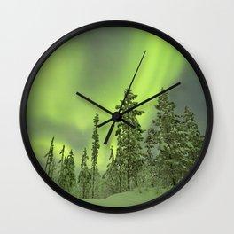 Aurora borealis over snowy trees in winter, Finnish Lapland Wall Clock