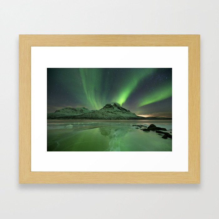 Aurora borealis over a frozen lake in northern Norway Framed Art Print