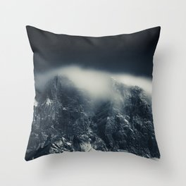 Darkness and white clouds over the mountains Throw Pillow