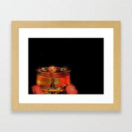 A lone flame Framed Art Print