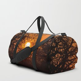 Sultry sun setting behind the sausage tree Duffle Bag