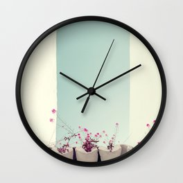 Pink flowers on the white rooftop Wall Clock