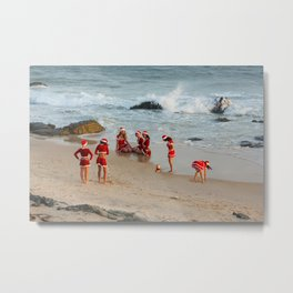 Christmas background. Happy girls in Santa Clause suit having fun on the beach. Metal Print
