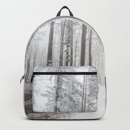 Mysterious road in a frozen foggy forest Backpack