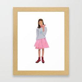 A girl playing ocarina Framed Art Print
