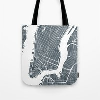 new york map Tote Bags featuring New York City map by Studio Tesouro