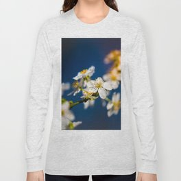 Beautiful White Jasmine Flowers With Green Leaves Against A Blue Background Long Sleeve T-shirt