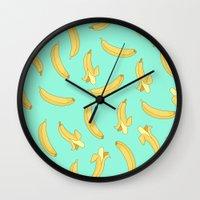 banana Wall Clocks featuring BANANA by Céline Dscps