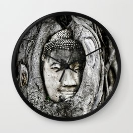 Buddha head entwined in Banyan tree roots. Wall Clock