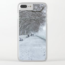 Leaving footprints under the cold freezing snow by the Lake Annecy in France Clear iPhone Case
