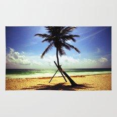 Palm on the beach. Rug