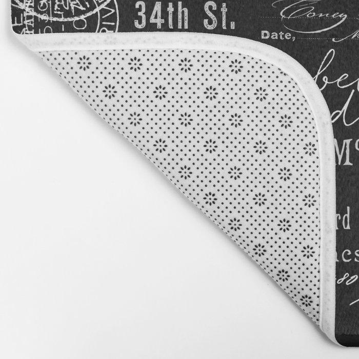 White Vintage Handwriting on Black Bath Mat