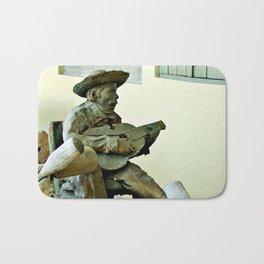 Jibaro Sculpture playing el Cuatro  Bath Mat
