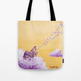 Penguin Playing A Song of Love on Piano Tote Bag