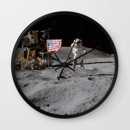 Astronaut John Young leaps from lunar surface to salute flag Wall Clock
