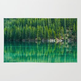 Reflective Green Pine Forest With Green Turquoise Waters Rug