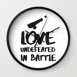 Love undefeated in battle Wall Clock