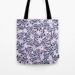 White flowers over a purple background Tote Bag
