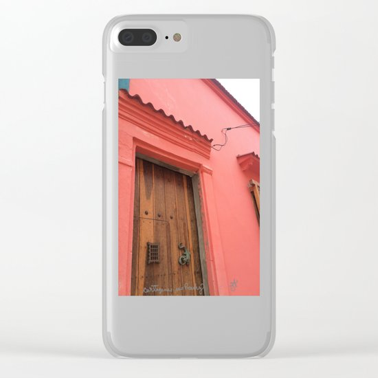 Cartagena is Peachy, Colombia, South America. Coral Pink Building with Ornate Lizard design Clear iPhone Case