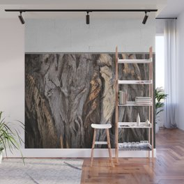 Abstract Human Figures in Gnarled Wood and White Cinder Block Wall Mural