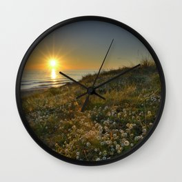 Sunset at the beach. White flowers on the sand Wall Clock