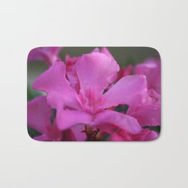 Pink Oleander Flower With Green Leaves in the Background Bath Mat