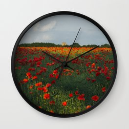 Church and field of red poppies in evening light. Holme Hale, Norfolk, UK Wall Clock