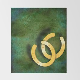 Lucky horseshoes on a textured green background Throw Blanket