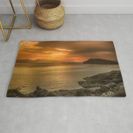 Sunset over Lismore Island of the shores of Oban in the west of Scotland. Rug
