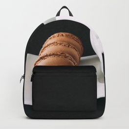 Set of cup of coffee and macaroons against black background Backpack