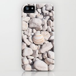 A seashell on white stones iPhone Case