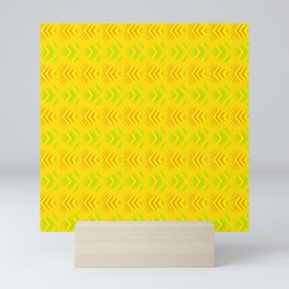 Pattern of intersecting orange hearts and green stripes on a yellow background. Mini Art Print