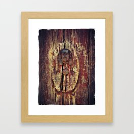 weathered wooden door with agypt door knocker Framed Art Print
