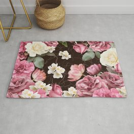 Bouquets of pink and white lush roses, tulips and jasmine. Rug