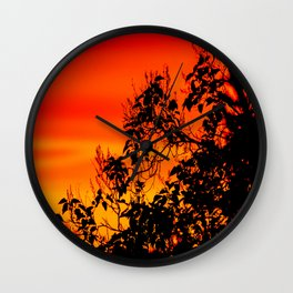 Silhouette of leaf with red autumn sky #decor #society6 Wall Clock
