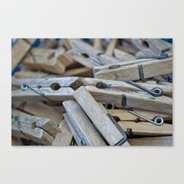 family wooden tongs Canvas Print