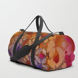 a piece of orange pink and purple Duffle Bag